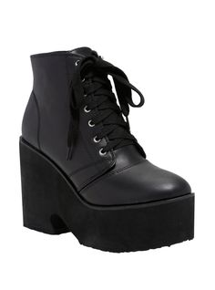 """Stomp, stomp, stomp around in these bad ass platform booties! The black faux leather lace-up front booties have the perfect platform height to be comfy in all day and then carry you into your night.    Man-made uppers  2"""" platform; 4 1/2"""" heel  Imported  Listed in junior sizes"""