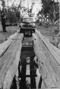 1940 Ford or Mercury car crossing Woolooma-Balpool bridge - Deniliquin, NSW, 1930 by Garry Daly by State Library of New South Wales collection. Old Pictures, Old Photos, Vintage Photos, South Wales, Outback Australia, Parks, Nostalgia, Mercury Cars, Camping