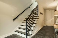 Transitional Staircase with High ceiling, Hardwood floors