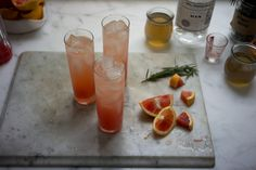 Blood Orange Gin Sparkler. If blood oranges are hard for you to come by - navel oranges are also delicious.    2 cups / 480 ml water  1 cup / 6.5 oz / 185 g sugar  4 tablespoons (~2 sprigs-worth) fresh rosemary leaves  1 bay leaf (optional)    blood oranges   gin  ice cubes  tonic water (or sparkling water)