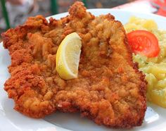 Eat a Schnitzel. The breaded veal cutlet is a staple of German cuisine, along with pork chops, pretzels, wurst and Käsespätzle (a sort of local mac and cheese). Oktoberfest Hairstyle, Oktoberfest Party, Wiener Schnitzel, Pork Schnitzel, Traditional German Food, Typical German Food, Pork Recipes, Cooking Recipes, Great Recipes