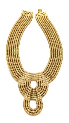 AUDEN Lenox Bib Necklace - Gold ($648) | ShopBop. Slinky snake chains compose this layered AUDEN necklace, which forms a sculptural loop pendant at the center. Box clasp. 14k gold plate. Length: 14in / 35.5cm. Drop: 8in / 20.5cm. Made in the USA.