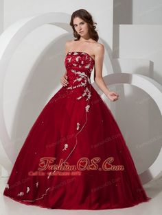 Customize Wine Red Quinceanera Dress with Appliques and Beading http://www.fashionos.com Get a celebrity look with this stunning ball gown dress. Its bodice is framed by a straight neckline and a uniquely shaped dropped waistline. The bodice is accented with stuning beads and floral appliques all the way round to the back. The full skirt accented with shimmering beads and white appliques flares out from thedropped waist to give this ball gown a special look