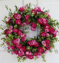 Beautiful ranunculus in hues of pink nestled in eucalyptus make this wreath perfect for an entry door or interior space. Vibrant and just loaded