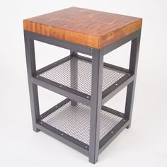 This custom industrial side table was designed around a butcher block cutting board we recycled from Goodwill. www.slipstreamcreations.com