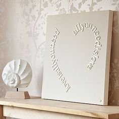 Think this could be a DIY project.  This design is made using 3d lettering in Times New Roman font (5cm x 4mm) mounted onto 60cm x 60cm x 3.5cm canvas. Beautifully finished in Gorgeous Graffitis signature creamy chalky white paint.  The cost of this online is $331