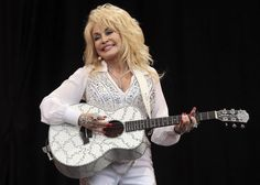 American country music star Dolly Parton performs on the Pyramid Stage at Worthy Farm in Somerset, during the Glastonbury Festival June 29, 2014. ― Reuters pic