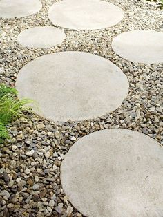 Circular Steppers Concrete steppers laid in gravel create a cute pathway that connects the outdoor room to the back of the house. By covering the yard with gravel, the homeowner has very little yard maintenance to deal with, giving him more time to enjoy the fruits of his labor. - Circular steppers make a geometric path that looks great. This is a great way to connect the front and backyard.