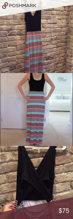 Maxi dress with Criss Cross in Back Maxi dress with Criss Cross in Back. Black top, striped bottom. The 4th photo shows the back but the other 3 photos are the exact dress! WORN ONCE Gilli Dresses Maxi