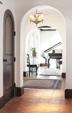 Spanish Colonial Remodel mediterranean - love the dark baseboards :) Estilo Colonial, Spanish Colonial, Spanish Revival, Spanish Style Homes, Spanish House, Dark Baseboards, Baseboard Styles, White Wood Floors, White Walls