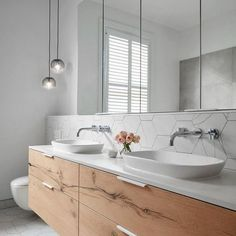Our design team loves including a floating vanity unit within their designs to enhance the illusion of space.Have your decided if your bathroom renovation will showcase a floating or freestanding vanity unit? Bathroom Renos, Laundry In Bathroom, White Bathroom, Bathroom Renovations, Modern Bathroom, Small Bathroom, Master Bathroom, Bathroom Vanities, Master Baths