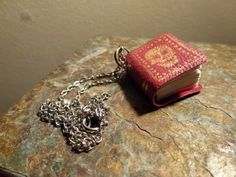 Nov Tiny handbound red leather book necklace, with gold skull details. By QueenHare for the Design Every Day Project Book Necklace, Pendant Necklace, Gold Skull, Leather Books, Red Leather, My Design, Detail, Day, Jewelry