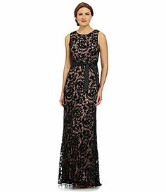 I OWN IT!!! Cut off the demi train when I had it hemmed and added cap sleeves with the lace  ;)   Adrianna Papell Sleeveless Lace Gown