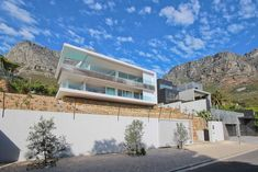 4 Bedroom House For Sale in Camps Bay in Camps Bay - 47 Hely Hutchinson Ave | Jawitz Properties American Shutters, Rectangular Pool, Roller Shutters, Shutter Doors, Table Mountain, 4 Bedroom House, Reception Rooms, Modern Homes, Back Gardens