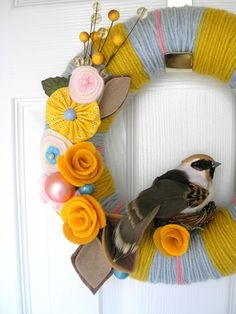 LOVE! not so much the bird though... i really need to make another yarn wreath..