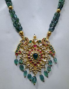 Antique emeerald necklace with kundan and ruby pendant Emerald Jewelry, Gold Jewelry, Beaded Jewelry, Beaded Necklace, Emerald Necklace, Pearl Necklace, Pendant Necklace, Ruby Pendant, Pendant Set