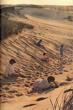 "July 1966 ""Amber fingers of dusk touch the dunes of Cape Cod National Seashore, but still the beachcombers linger."
