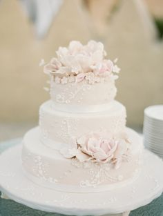 Elegant ivory + blush wedding cake: http://www.stylemepretty.com/destination-weddings/2016/04/11/intimate-abu-dhabi-wedding-complete-with-camels/ | Photography: Rebecca Hollis - http://rebeccahollis.com/