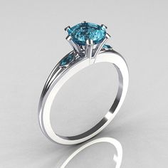 Plantinum and aquamarine wedding ring on Etsy listing at https://www.etsy.com/listing/79482457/ultra-modern-950-platinum-10-carat-round