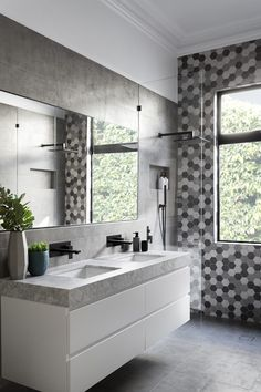 GIA renovations have created a modern grey and white bathroom with matte black accents, that proves you don't always need a lot of color in an interior.