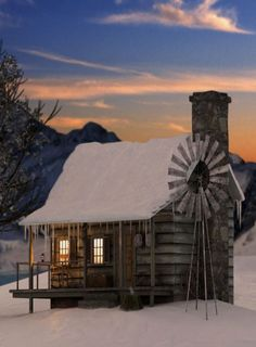 WINTER – a warm cabin in winter with a windmill in the snow.