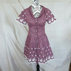 """SALEEmbroidered Pink Retro Dress Gorgeous pink checkered dress with floral embroidery on the skirt and sleeves. Swing style skirt. Functional buttons down the front. Size Medium. Brand new with tags! Measurements: Bust-14"""", Waist-15"""", Hips-Free. Pixie Dresses Mini"""