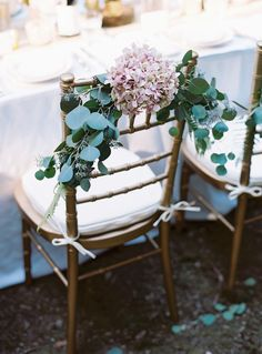 Hydrangea and Greens Natural Chair Decoration | Austin Gros https://www.theknot.com/marketplace/austin-gros-nashville-tn-356251 | Wine Country Party & Events https://www.theknot.com/marketplace/wine-country-party-and-events-sonoma-ca-543719