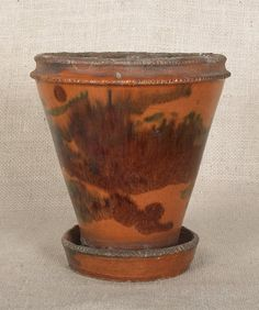 Pennsylvania redware flower pot, 19th c.,