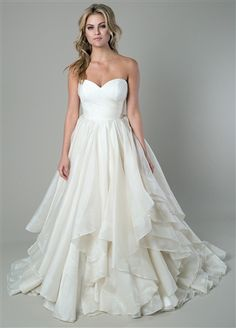 Beautiful Organza Ball Gown with a Romantic Strapless Sweetheart Neckline, Ruched Fitted Bodice to Natural Waistline, Lightly Padded Bust Cups and Interior Boning for Figure Flattery, Gathered Organza Handkerchief Layered Ball Gown Skirt, Court Train, Mid V-Back with Covered Buttons over Hidden Zipper.