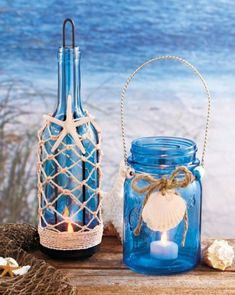 Beach seaside blue glass mason jar bottle candle holder with nautical decor. Beach Theme Centerpieces, Beach Wedding Decorations, Wedding Beach, Trendy Wedding, Wedding Ideas, Diy Wedding, Beach Weddings, Centerpiece Ideas, Wedding Table