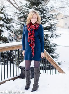 snowy day outfit with leg warmers and a sweater dress