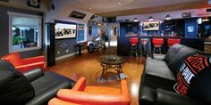 like this for man cave (less Harley, maybe rugs?)