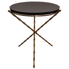 Bamboo line elegant table with brass stucture and black marquinia
