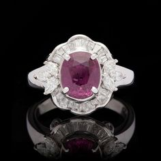 Purplish Red Cushion Cut Ruby Ring | From a unique collection of vintage cocktail rings at https://www.1stdibs.com/jewelry/rings/cocktail-rings/