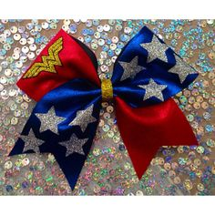 Cheer Bow Wonder Woman Glitter ($12) ❤ liked on Polyvore featuring accessories, hair accessories, black, sparkly hair accessories, bow hair accessories and glitter hair accessories