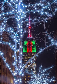 The Empire State Building glows in Christmas colors by Noel YC @nyclovesnyc by newyorkcityfeelings.com - The Best Photos and Videos of New York City including the Statue of Liberty Brooklyn Bridge Central Park Empire State Building Chrysler Building and other popular New York places and attractions.