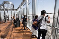 Burj Khalifa new observation deck - Tourists got an exclusive opportunity to snap away from the monstrously high view - To get there, sightseers have to change lifts on level 125. Previously tourists could only go to an observation deck on the 124th floor. Nearly 1.9 million visitors did so last year.