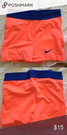 Dri-fit Nike pro spandex shorts Brightly orange/blue colored Nike pro spandex shorts!! Never worn! Nike Shorts