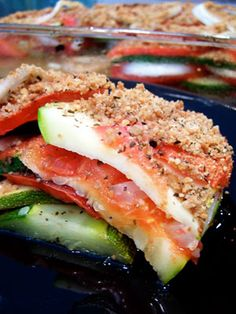 Veggie Bake layered with zucchini, tomatoes, vidala onions, spices....