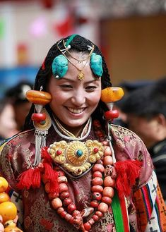 Tibetan beauty with traditional festive jewelry and ornaments