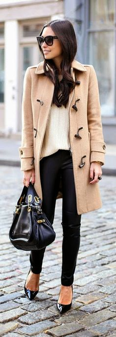 Leather Leggings in Soho - camel coat with leather leggings and cream sweater and black leather hand bag and nude black pumps.