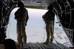AFGHANISTAN — Two Chinook air crew members on the trip home from a  visit to Border Police garrisons near Pakistan. (U.S Army Corps of Engineers photo by Mark Ray)