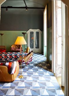 The idea of a tile floor may conjure up images of linoleum or of bland, dirt-colored ceramic tile, but tile floors can also be really lovely — breathtaking, scene-stealing, even. If you need a little convincing, take a look at these 19 stunning examples, which may have you re-considering your next renovation.