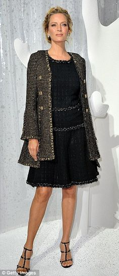 Uma Thurman glows in classic Chanel tweed dress and coat.