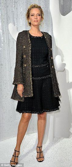 Uma Thurman glows in classic Chanel tweed dress and coat.