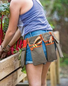 DIY this with webbing for belt and sewn pockets. Gardeners Tool Belt