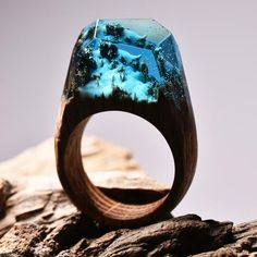 """Enchanted Forest Wander into the wintry wonders of the Enchanted Forest. This ring is made oflight blue resin and white """"snow"""" that glows in the dark. The base"""