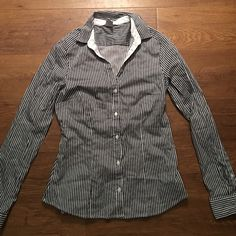 7405f20dd53 H M Button Down Shirt H M navy and white button down shirt NWOT. The shirt  is a size 8 but runs small. It has a feminine shape and is very flattering  on!