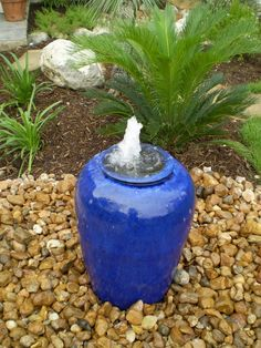 "Build a water feature that dogs can safely drink. Ensure that any pond or fountain has regular water exchange so it doesn't become stagnent. ""Pondless"" water features such as these are safer for kids, too! But make sure Fido can't knock it over! I LOVE this water feature."
