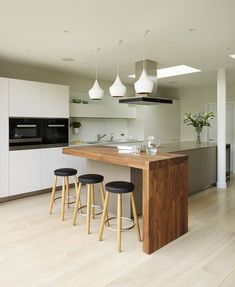 Nice kitchen design with white cabinets and wood kitchen island